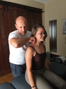 This is a picture of Edmonton chiropractor Dr. Dean Collins giving a chiropractic adjustment to a patient